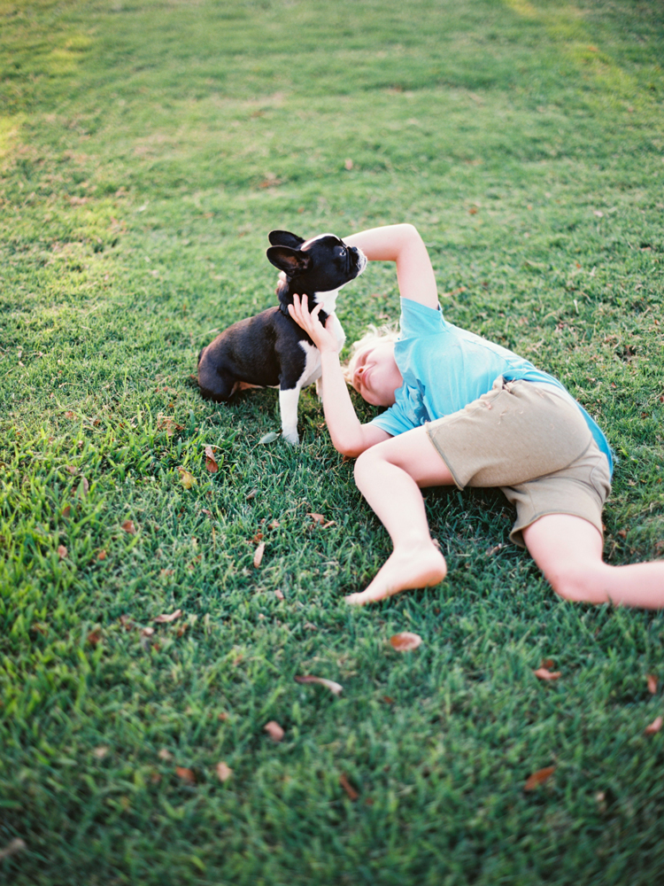 boy-and-dog-playing-in-the-grass.jpg