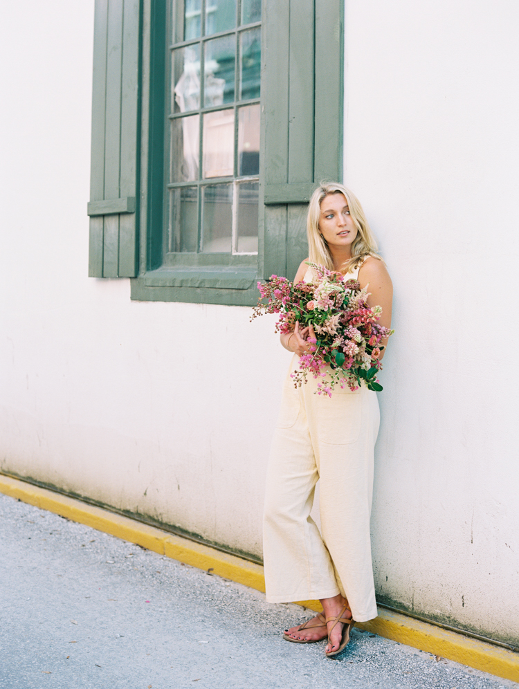 woman holding pink bouquet in saint augustine