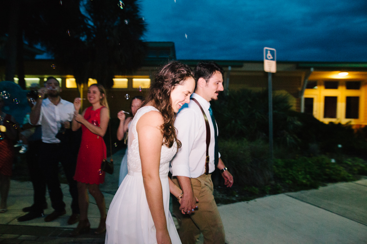 happy couple leaving their reception