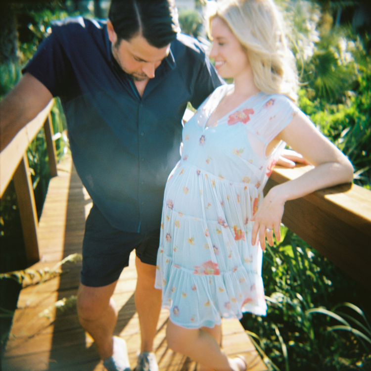man staring at wife's pregnant belly