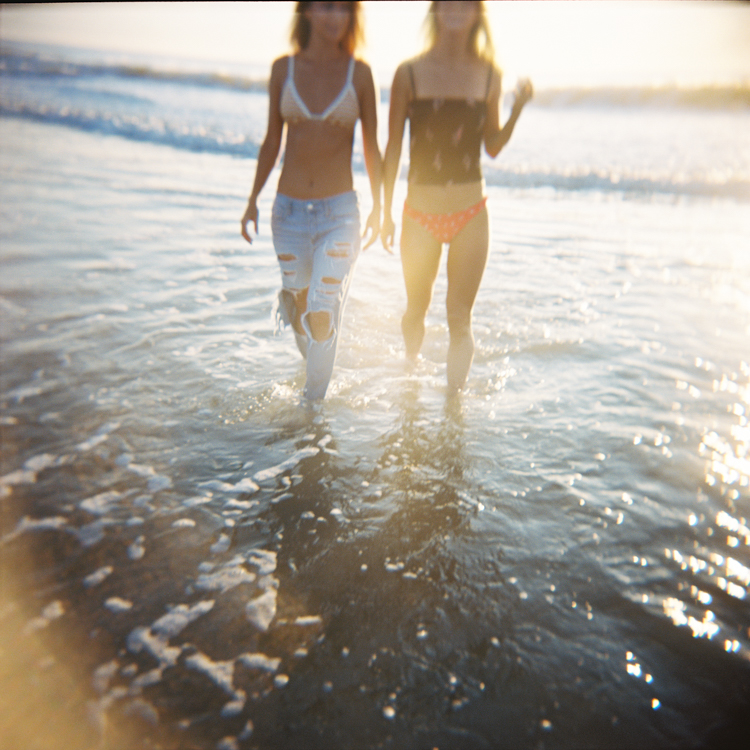 holga photo of twin models in the ocean