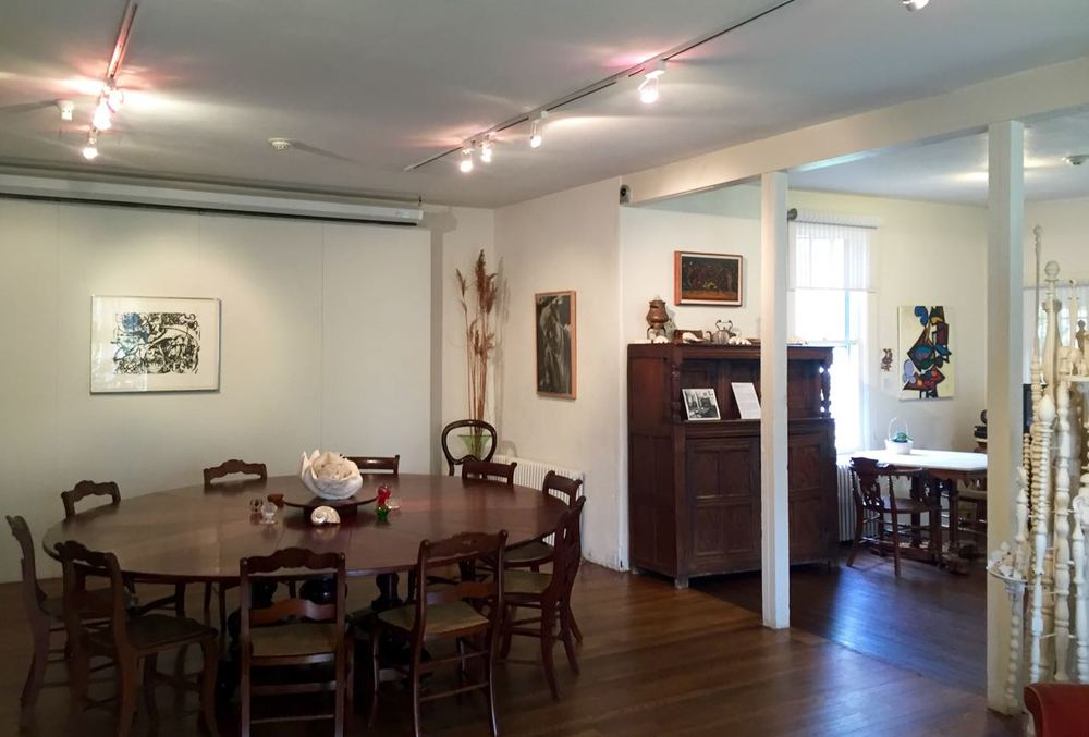 In 1958 Lee replaced their rectangular dining room table with a larger, circular table that is on view today. She found the custom made, English table at a moving sale in town, and its wedges can be removed to adjust the table's size. It is not the same table that Jackson Pollock famously flipped over in his biopic.