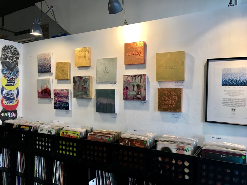 Gold leaf text paintings & mixed media works above the records