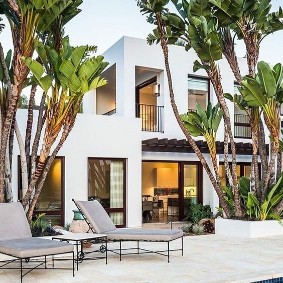It's hard to beat any white structure sitting pretty next to a gathering of palms, am I right?  Getting very full of heart-eyes over this home built by Neumann Mendro Andrulaitis Architects in lovely Santa Barbara.  Photo by Ciro Coelho Photography  #dmarinteriors #californiamoderninteriors #tastfultailoredtimeless #hospitalityart #losangelesinteriordesigner #livingroomdecoration #architecturepicture #kitchenart  #aestheticbyme  #pyttliving #custombuilt #architecturelove #custombuild #officedesigntrends #architecturelife #luxuriouslife #luxuryinterior #instainteriors #californiaphotography #californiastyle  #luxury #luxuryhomes #luxurystyle #luxuryrealestate #luxurylifestyle #luxurybrand #interiors #interiordecor #instalove #instagood #likeforlike #like4like  #instapic