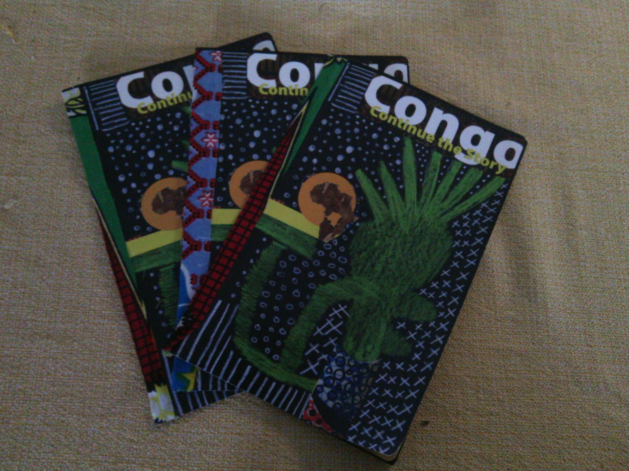 The front of the books are decorated with Congolese cloth and hand sewn.