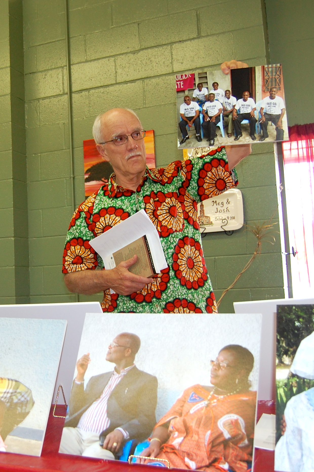 Jim Calli, GBA Board member, displays photographs from DR Congo