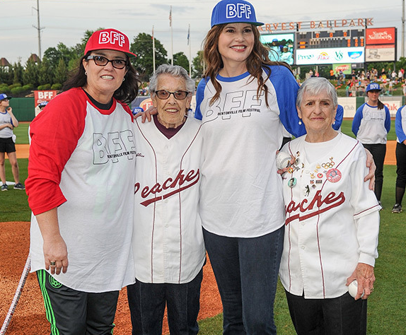 By   MADISONJAYE    Yup, you read that right! A real life reunion of 'A League of Their Own' has taken place– and we've got the heart wrenchingly adorable pics to prove it!  Admit it: you still freaking adore  A League of Their Own . Don't worry, we do too, which is why this is basically the best thing to ever happen. On May 7, at Arvest Park in Springdale, Arkansas there was a completely epic reunion of the 1992 film's original stars,   Rosie O'Donnell    and  Geena Davis . The women were on hand to celebrate Geena's Bentonville Film Festival– and they were even joined by the two women on whom their characters in the movie were based! Too cute for words!     'A League Of Their Own' Reunion Pics  It's  A League of Their Own  on so many levels.  Do you still love 'A League of Their Own'  Sisters  Gina Casey  and  Alice Fracasso,  on whom the classic baseball flick was based, founded the All American Girls Professional Baseball League way back in 1943. All these years later, both women showed up to the Film Festival to celebrate the movie, and fans were treated to a super special moment: appearances by the women's onscreen counterparts!  Better still, all the women participated in a softball game because, I mean, necessary. All four also adorably posed together, basically making our hearts explode with cuteness, before a screening of the film (which also starred   Madonna ,  remember) was screened for those in attendance.  Championing Women  While the event was obviously full of fun and games, it wasn't  all  fun and games.     read more: http://hollywoodlife.com/2015/05/08/a-league-of-their-own-reunion-rosie-odonnell-geena-davis-pic/#