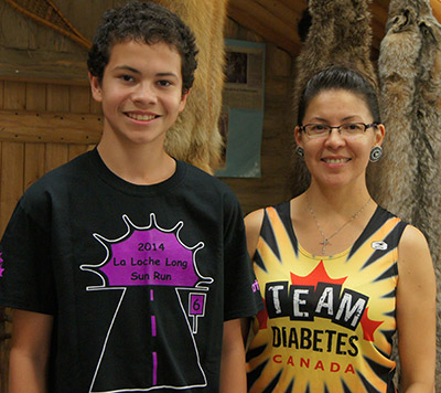 Bibianna King realized a childhood dream when she completed her first mara- thon for Team Diabetes in 2006. Since then, she's become an inspirational champion of health in her Northern Saskatchewan community. Nolan Kilfoyl- Herman (left) is one of the students who – encouraged by Ms. King – brought healthy treats for a class party when he was in Grade 3.   SUPPLIED