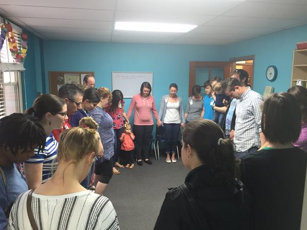 Children's ministry prayer huddle at The Journey - Tower Grove in St. Louis, MO. Photo by Jeff Hutchings.