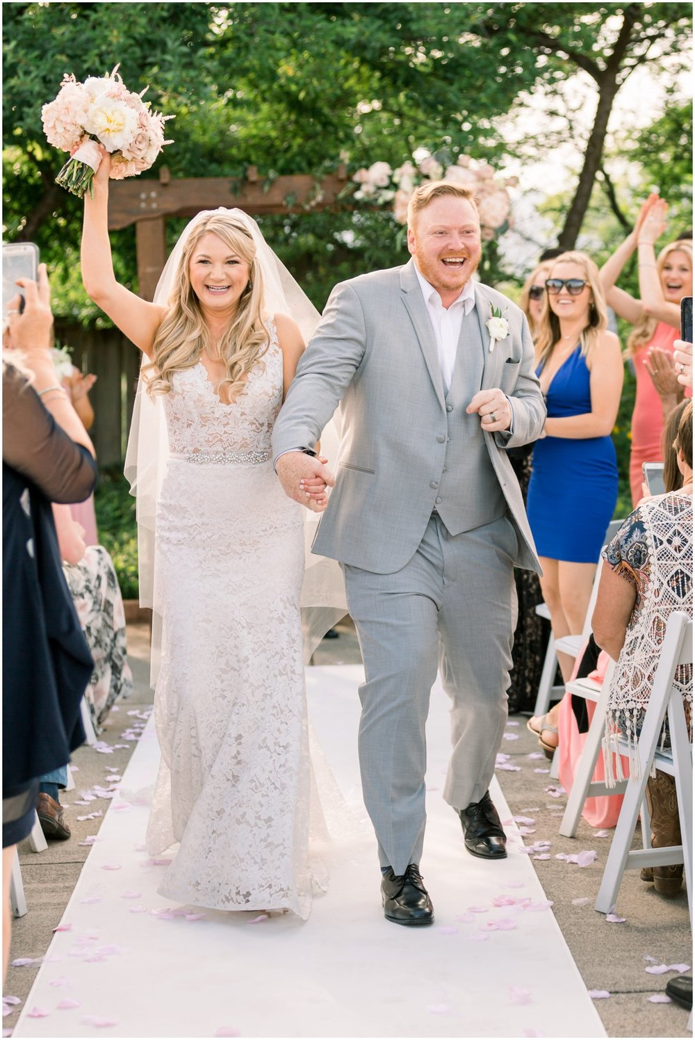 Cindy & Joseph walk out of their ceremony as Mr. and Mrs. This is one of my favorite photos ever!