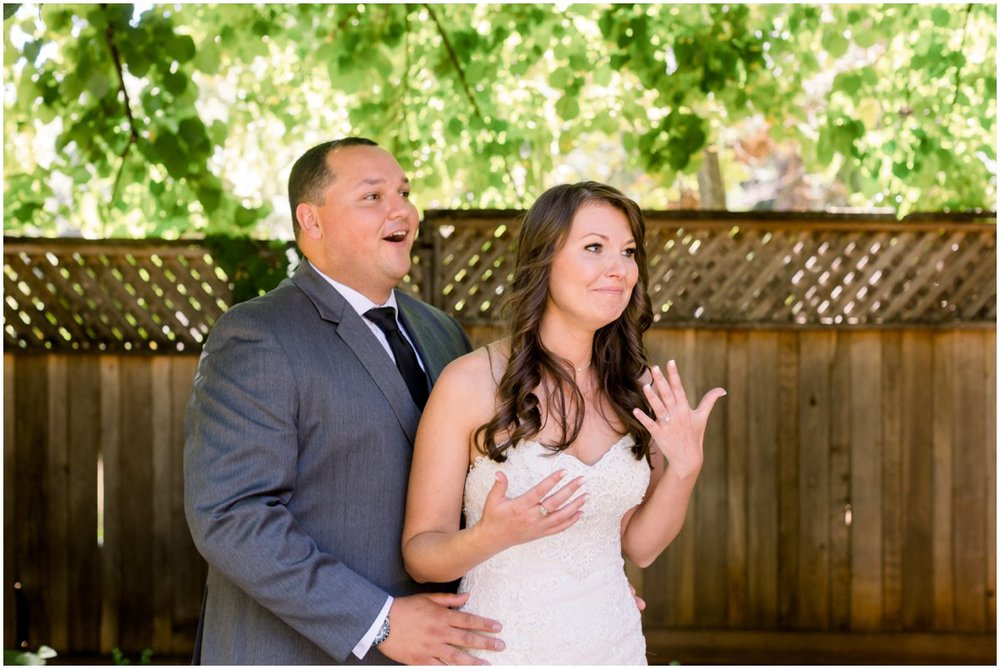Katie & Kurtis react to her sister surprising them with their doggies at the wedding. See next photo.