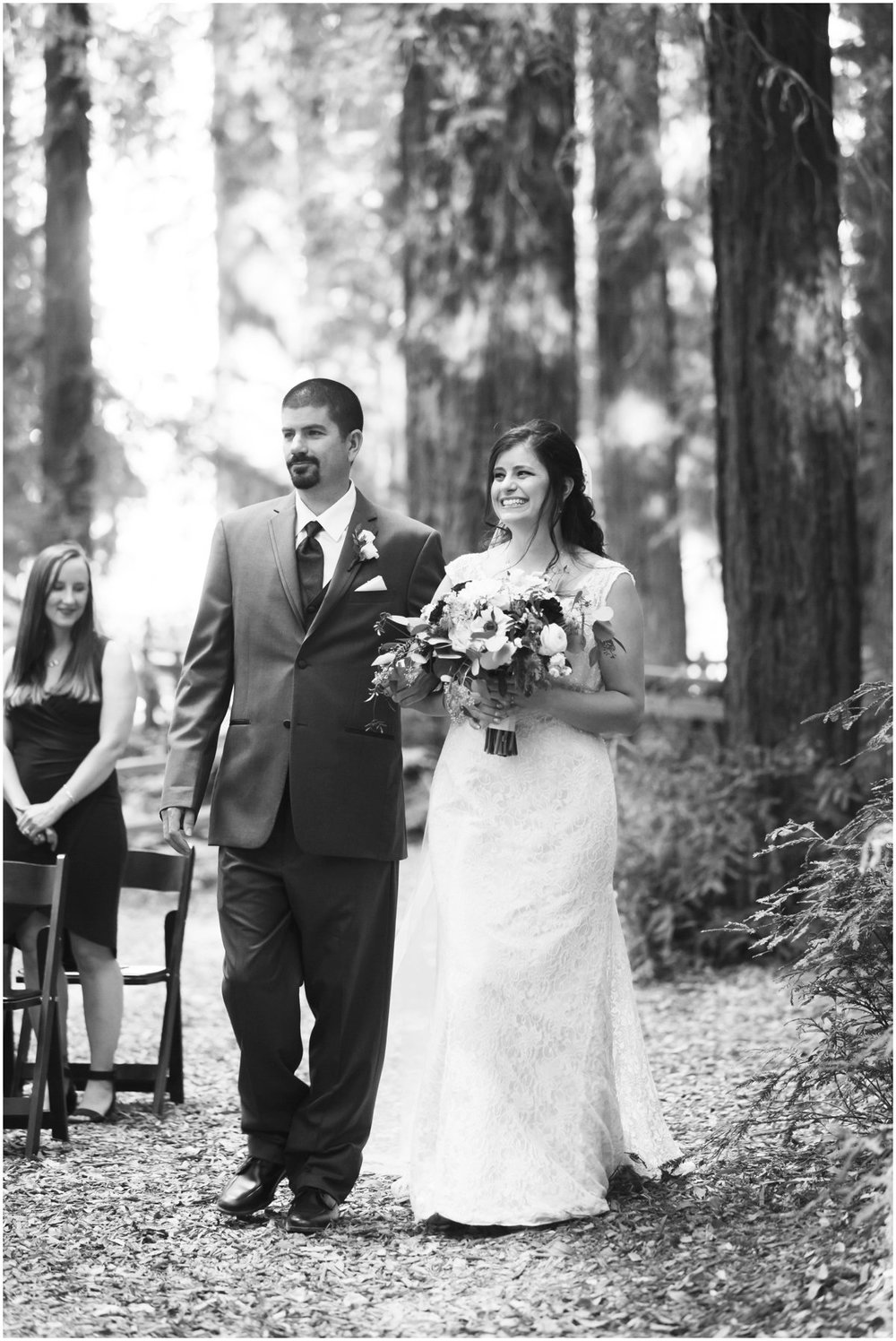 Selena smiling from ear to ear as she walks down the aisle to her groom