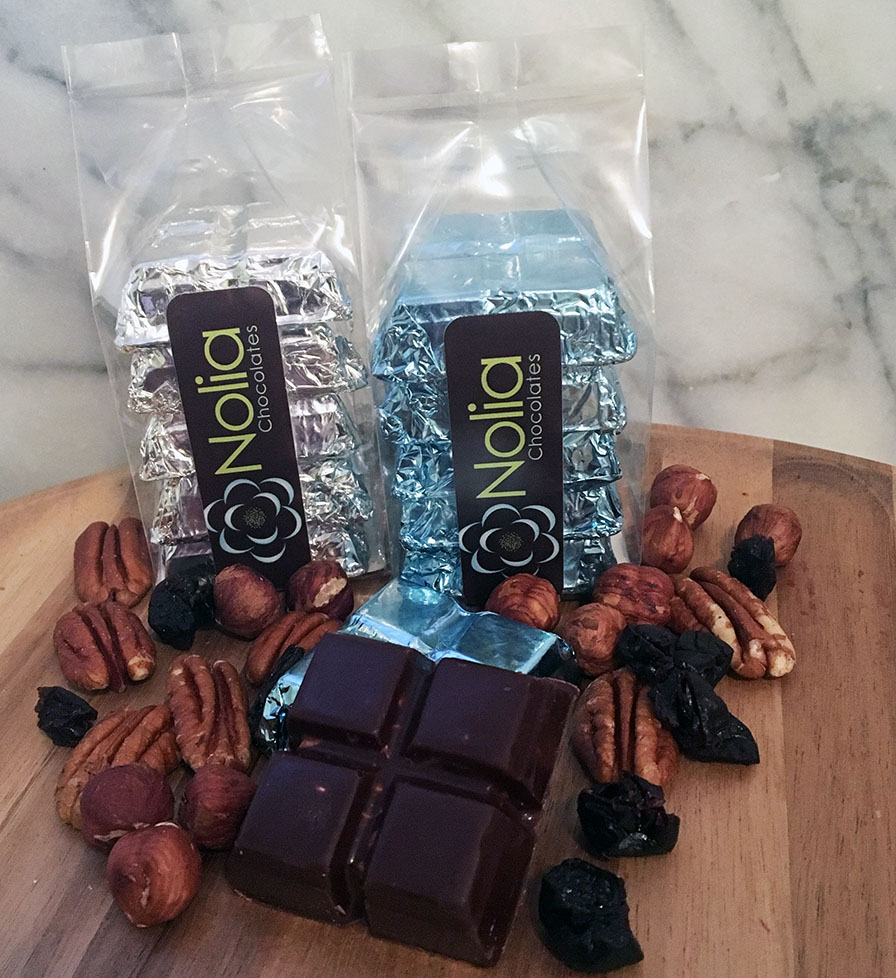"Fruit + Nut Squares - A decadent adult version of the ""chunky"" bar, each 1.5"" square contains cashews, almonds, walnuts, and dried apricots, cranberries, and raisins. In milk or dark chocolate, they come either 2 or 5 per package. Dark chocolate is non-dairy vegan."