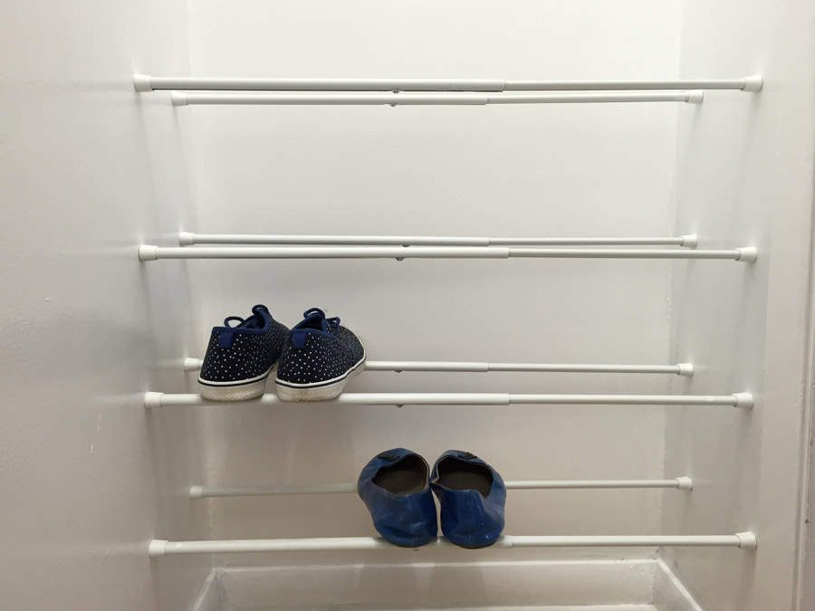 Tension rod shoe rack.jpg