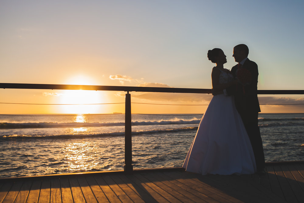 Bride and groom silhouette in front of sunset in Mauritius