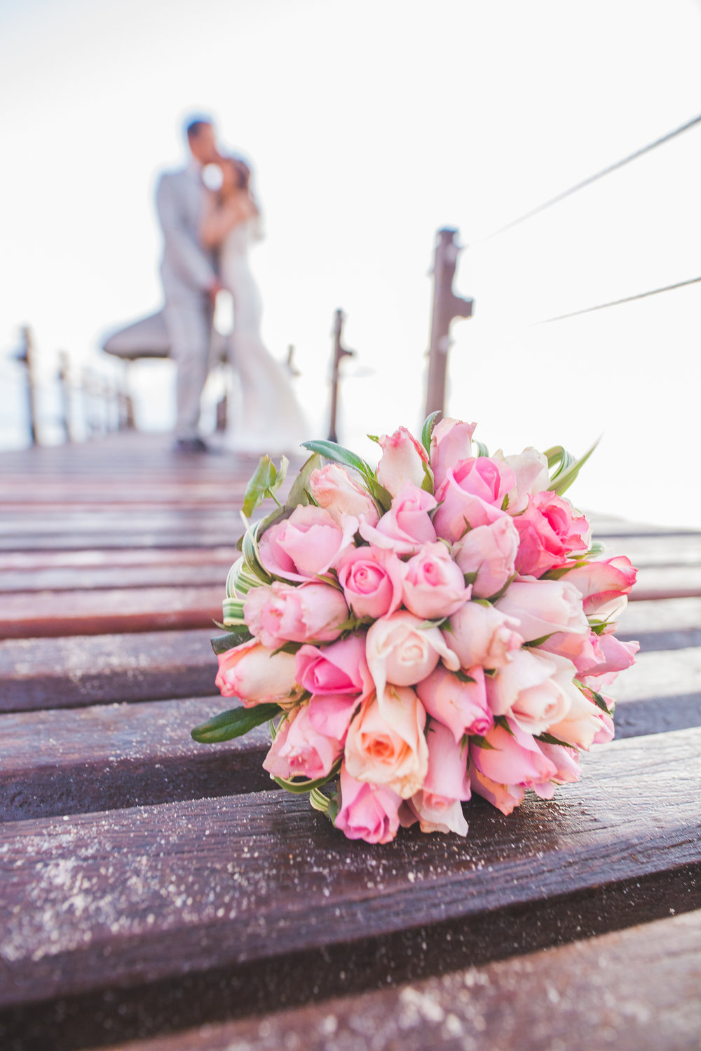 Wedding Flower and Couple on a Jetty in Mauritius