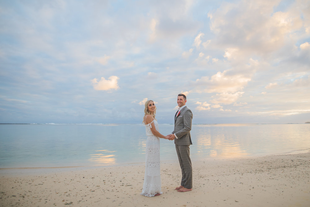 Maried Couple Holding hands on a Beach in Mauritius