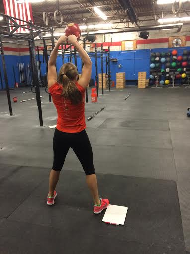 Michele had to do kettlebell swings alone because she finished her run so fast. 1:41!