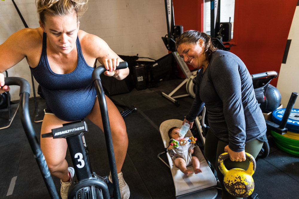A couple of the fittest moms we know, Coach Kait Ilch & Keri Wisey (w/ Grace) Photo: @supercleary