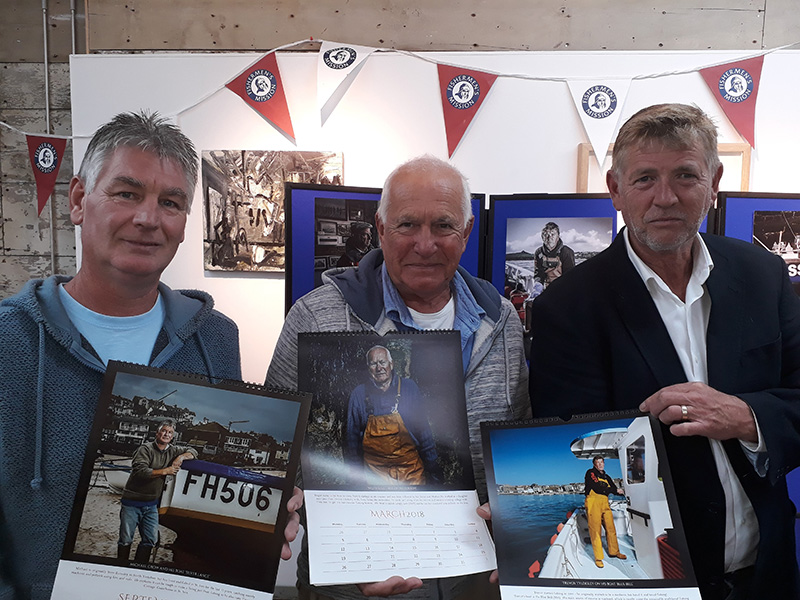 The Fishermen of St. Ives showing off their pages in the Calendar