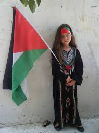 Young Palestinian girl with flag! Teach them when they are young!