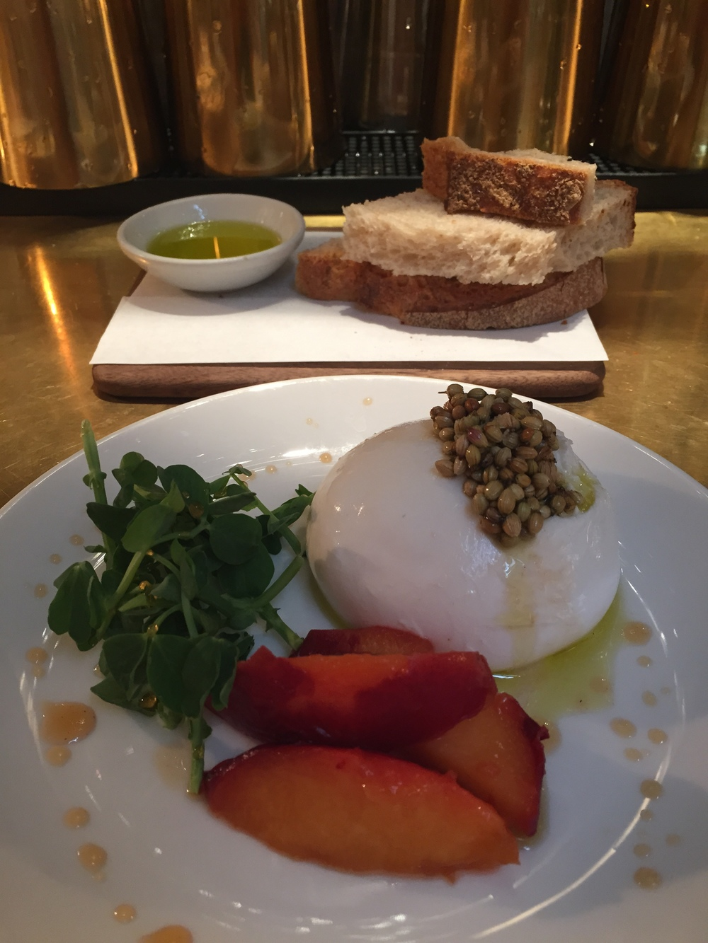 NOPI's exquisite Burrata with flavored peaches. YUM.
