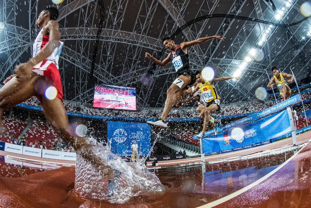 Competitors in action during the men's 3000m steeplechase final at the athletics competition at the 28th Southeast Asian Games at the National Stadium on June 12, 2015 in Singapore.