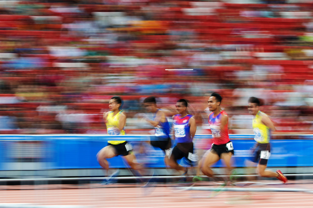Competitors in action during the men's 110m hurdles final at the 28th Southeast Asian Games at the National Stadium on June 11, 2015 in Singapore.