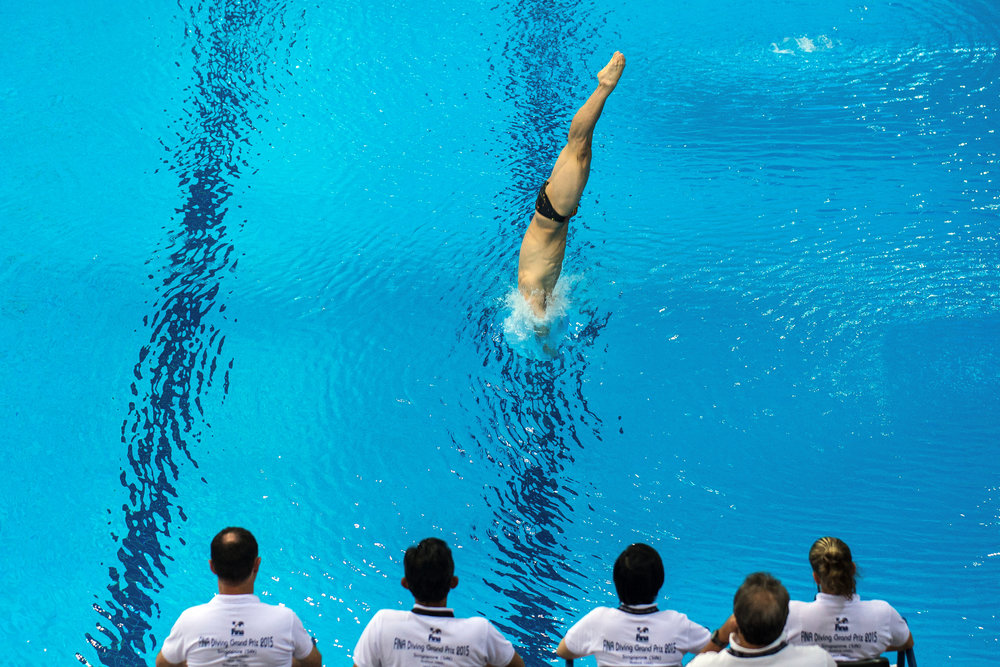 Peng Jian Feng of China in action during the men's 3m preliminaries on day one of the FINA Diving Grand Prix 2015 at the OCBC Aquatic Centre on October 16, 2015 in Singapore.