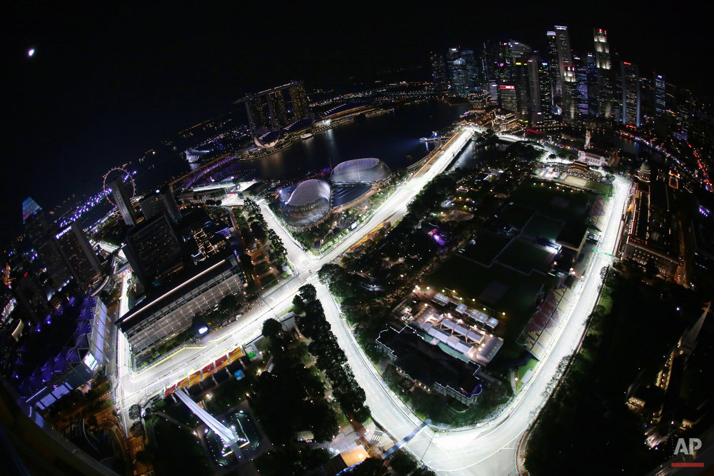The Singapore Grand Prix's Marina Bay City Circuit taken with a fish-eye lens at dusk from a hotel suite in Swissotel The Stamford in Singapore is seen on Thursday, Sept. 15, 2016. (AP Photo/Yong Teck Lim)