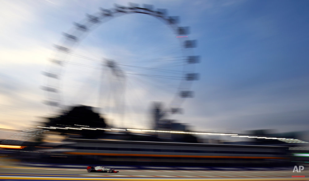 Haas driver Romain Grosjean of France steers his car during the third practice session for the Singapore Formula One Grand Prix on the Marina Bay City Circuit in Singapore, Saturday, Sept. 17, 2016. (AP Photo/Yong Teck Lim)