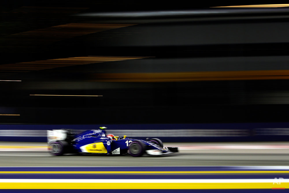 Sauber driver Felipe Nasr of Brazil steers his car during the qualifying session for the Singapore Formula One Grand Prix on the Marina Bay City Circuit in Singapore, Saturday, Sept. 17, 2016. (AP Photo/Yong Teck Lim)
