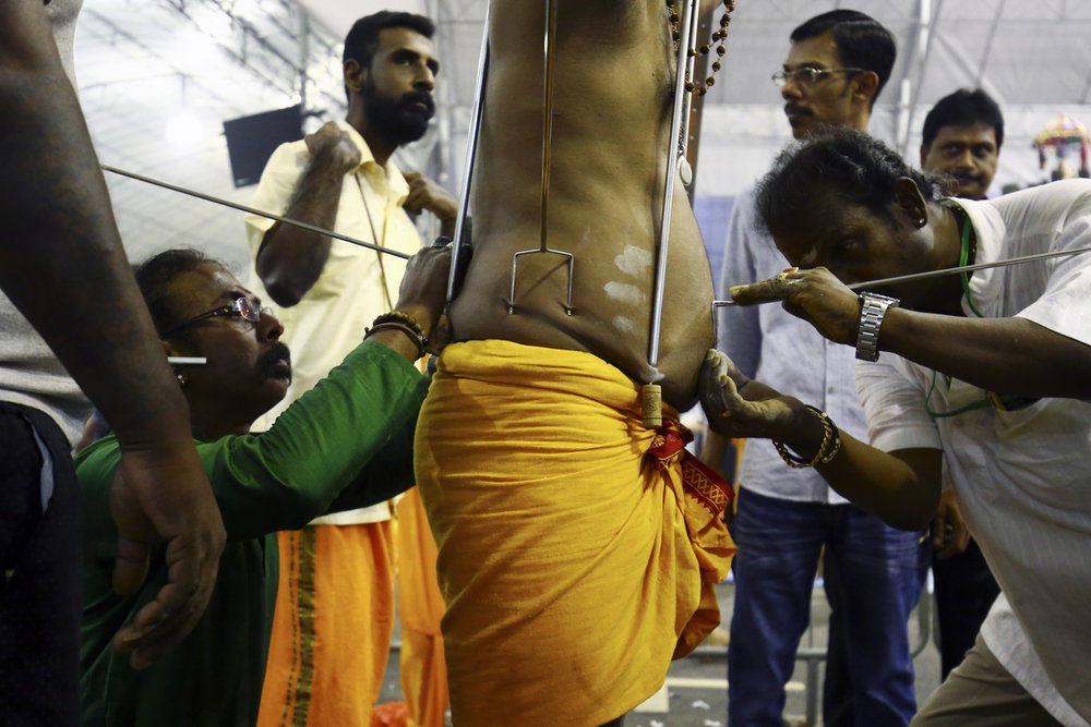 A devotee has his body pierced during the Thaipusam festival at the Sri Srinivasa Perumal Temple on February 9, 2017 in Singapore.
