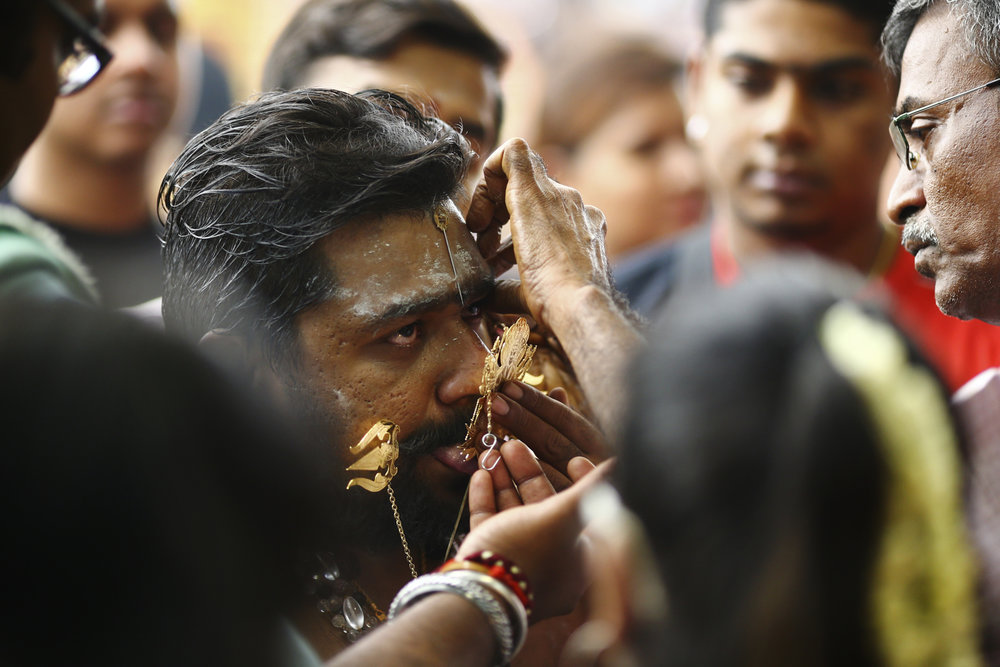 A devotee has his cheeks and tongue pierced during the Thaipusam festival at the Sri Srinivasa Perumal Temple on February 9, 2017 in Singapore.