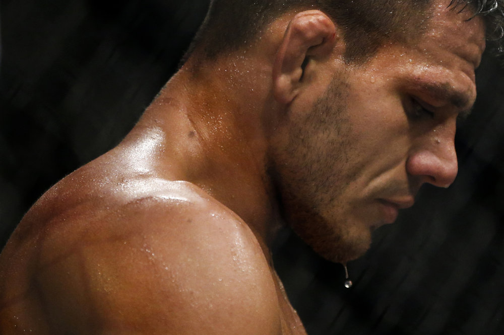 Rafael dos Anjos of Brazil takes a break during welterweight bout against Tarec Saffiedine of Belgium during the UFC Fight Night at the Singapore Indoor Stadium on June 17, 2017.