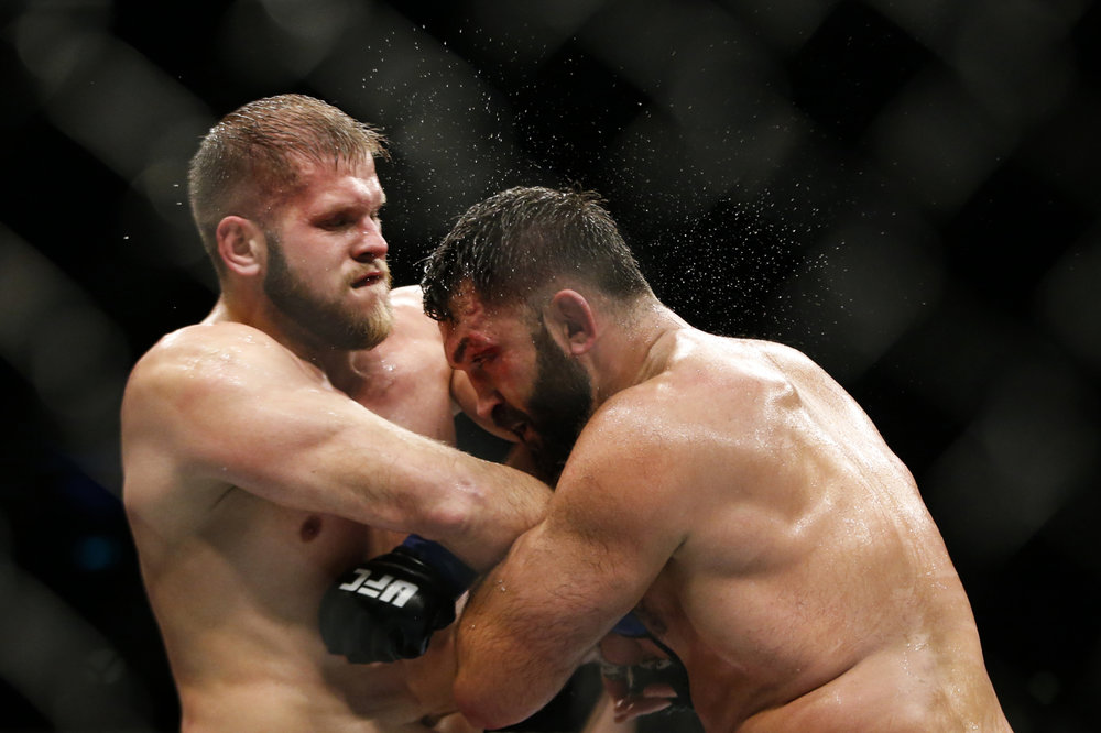 Andrei Arlovski (R) of Belarus fights Marcin Tybura of Poland during their heavyweight bout at the UFC Fight Night at the Singapore Indoor Stadium on June 17, 2017.