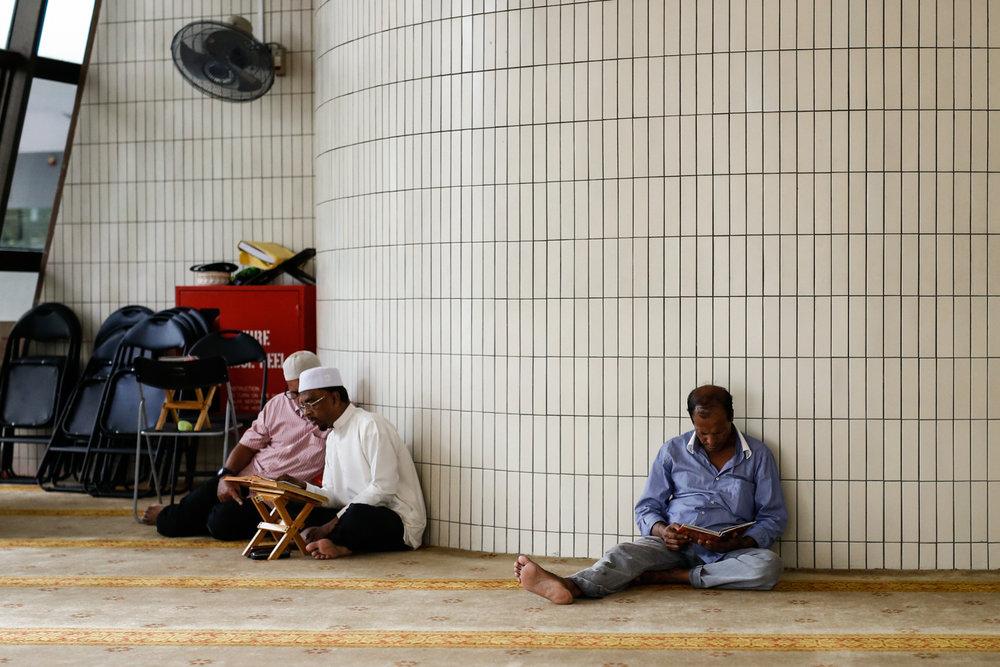 Muslim devotees read the Quran at Masjid Al-Mukminin.