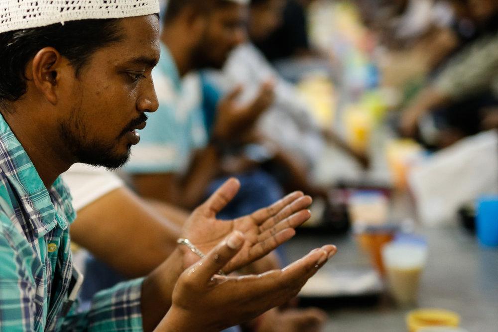 A Muslim devotee prays before iftar at Masjid Al-Mukminin.