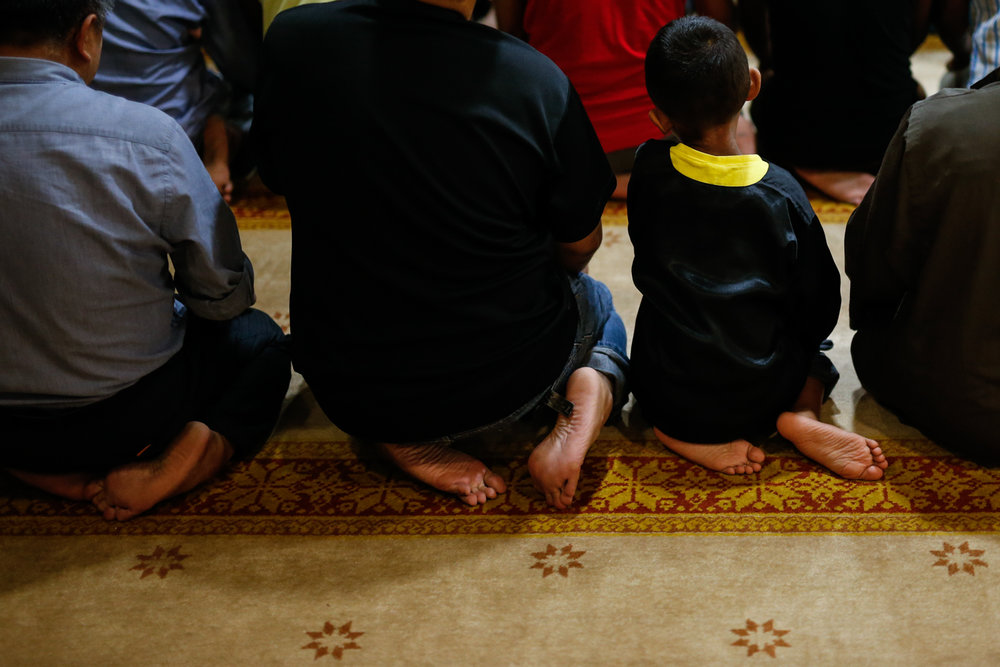 Muslims take part in tarawih prayers at Masjid Al-Mukminin
