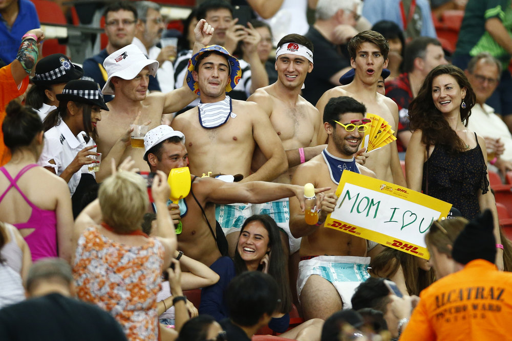 Rugby Union - Singapore Sevens - National Stadium, Singapore, 15/04/17 - Fans dressed in costumes react. REUTERS/Yong Teck Lim