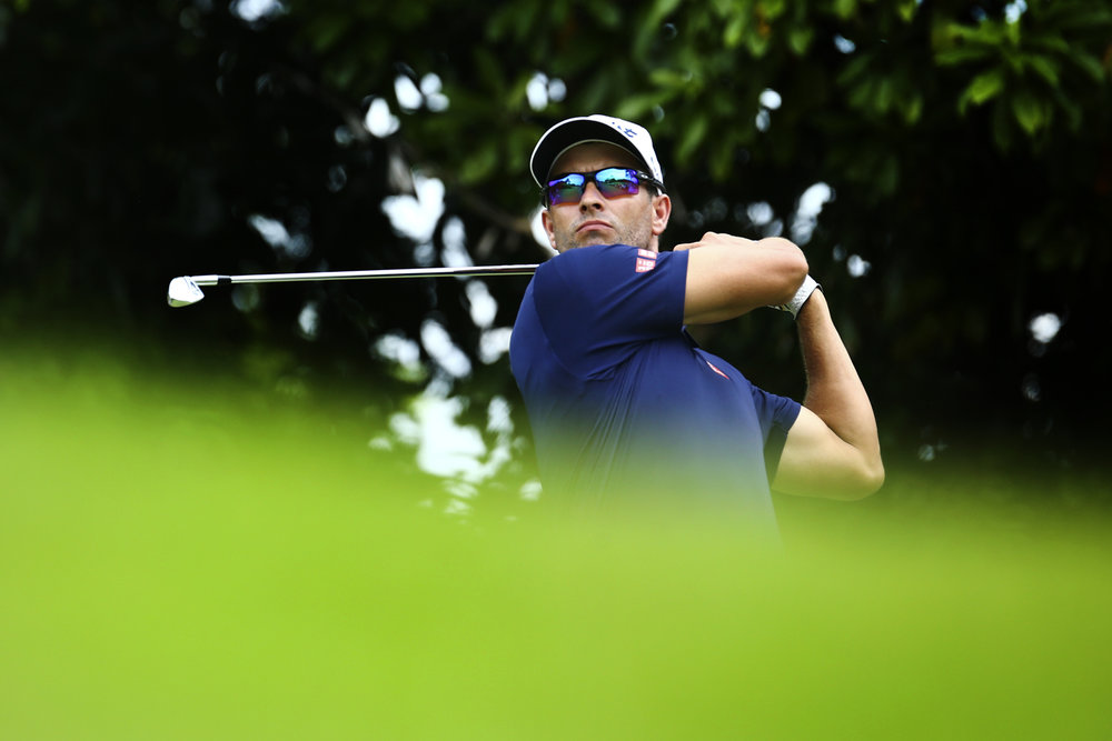Adam Scott of Australia tees off on the eighth hole during the second round of the SMBC Singapore Open golf tournament at Sentosa's Serapong golf course in Singapore January 20, 2017.