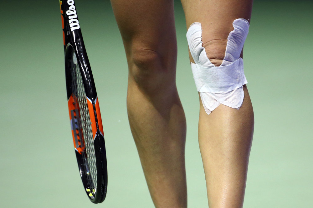 Tennis - BNP Paribas WTA Finals - Singapore Indoor Stadium - 27/10/16 Romania's Simona Halep with a bandage on her left knee during her round robin match Mandatory Credit: Action Images / Yong Teck Lim Livepic EDITORIAL USE ONLY.
