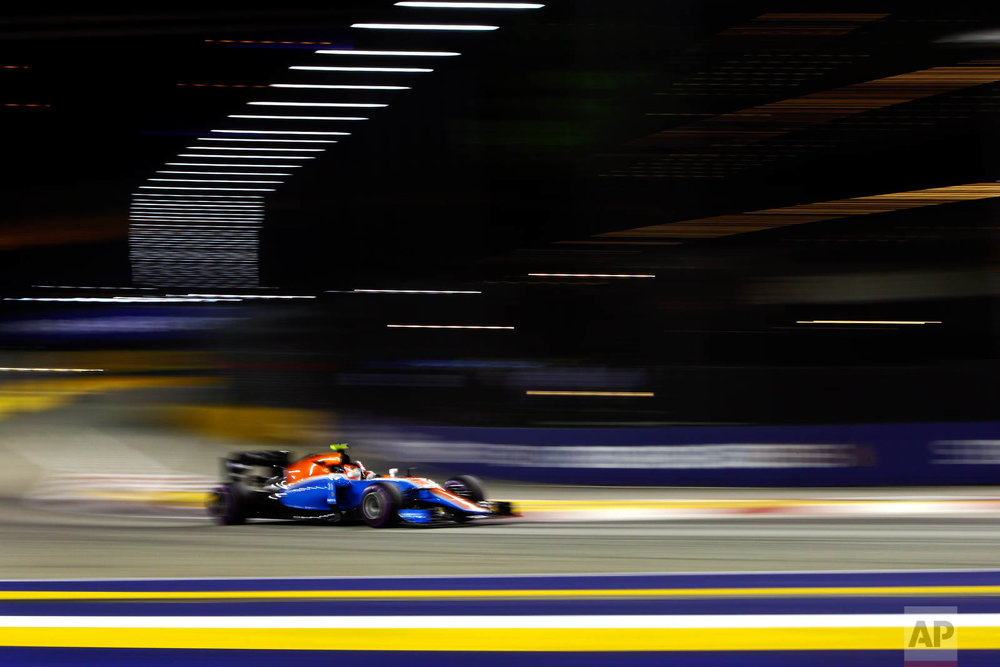 Manor driver Esteban Ocon of France steers his car during the qualifying session for the Singapore Formula One Grand Prix on the Marina Bay City Circuit in Singapore, Saturday, Sept. 17, 2016. (AP Photo/Yong Teck Lim)