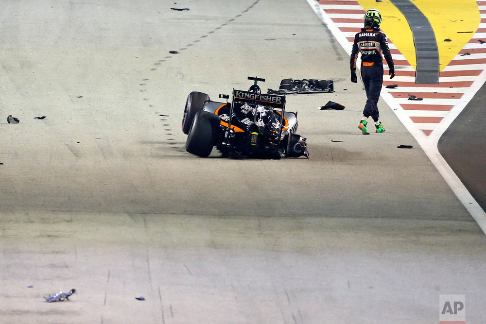Force India driver Nico Hulkenberg of Germany walks from his car after crashing at the start of the Singapore Formula One Grand Prix on the Marina Bay City Circuit in Singapore, Sunday, Sept. 18, 2016. (AP Photo/Yong Teck Lim)