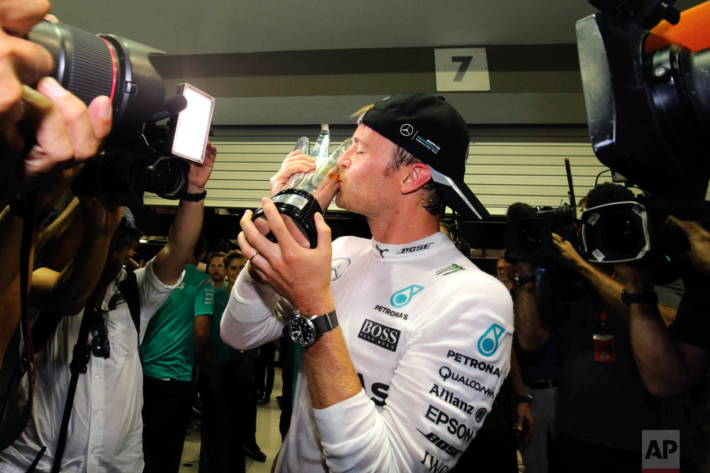Mercedes driver Nico Rosberg of Germany celebrates after winning the Singapore Formula One Grand Prix on the Marina Bay City Circuit Singapore, Sunday, Sept. 18, 2016. (AP Photo/Yong Teck Lim)