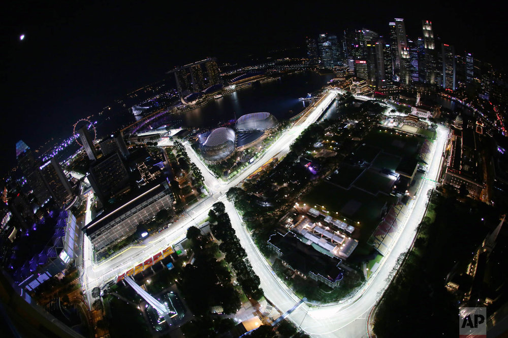 The Singapore Grand Prix's Marina Bay City Circuit taken with a fish-eye lens from a hotel suite in Swissotel The Stamford in Singapore is seen on Thursday, Sept. 15, 2016. (AP Photo/Yong Teck Lim)