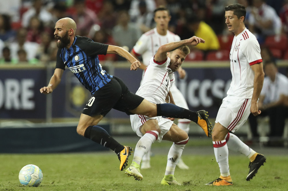 Soccer Football - Bayern Munich v Inter Milan - International Champions Cup Singapore - Singapore - July 27, 2017 Inter Milan's Borja Valero is tackled by Bayern Munich's Niklas Dorsch. REUTERS/Yong Teck Lim