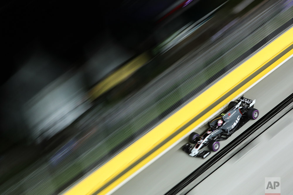 Haas driver Kevin Magnussen of Denmark steers his car during the second practice session at the Singapore Formula One Grand Prix on the Marina Bay City Circuit Singapore, Friday, Sept. 15, 2017. (AP Photo/Yong Teck Lim)