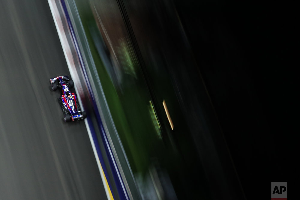 Toro Rosso driver Carlos Sainz Jr.of Spain steers his car during the second practice session at the Singapore Formula One Grand Prix on the Marina Bay City Circuit Singapore, Friday, Sept. 15, 2017. (AP Photo/Yong Teck Lim)