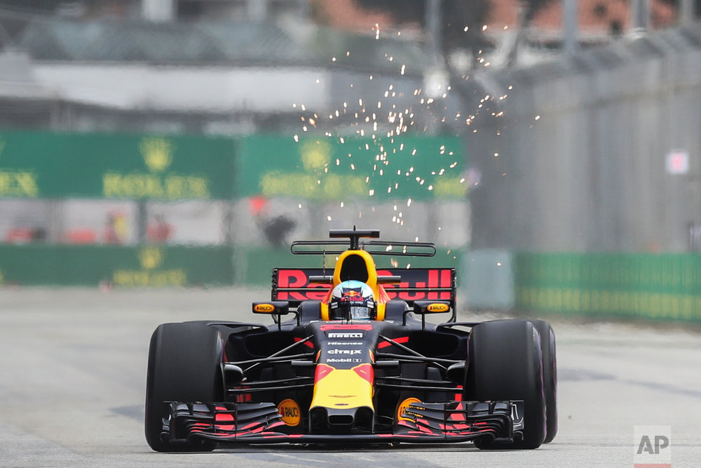 Red Bull driver Daniel Ricciardo of Australia steers his car during the first practice session at the Singapore Formula One Grand Prix on the Marina Bay City Circuit Singapore, Friday, Sept. 15, 2017. (AP Photo/Yong Teck Lim)